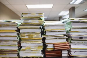 pile of files and books representing files